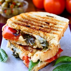 Caprese Panini Sandwich | The classic flavors of a Caprese salad all wrapped up in a crisp panini sandwich and grilled to perfection! | www.heavenlyhomecooking.com