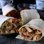 Grilled chicken, cucumber, bean sprout and carrot salad, dressed with a spicy peanut sauce and wrapped up in a flour tortilla. A delicious sandwich for lunch or dinner!