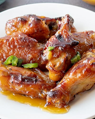 Sweet and Spicy Chicken Wings | Green hot pepper sauce and jalapenos give these wings the spicy, honey gives them the sweet. It's a complementary pairing that will bring you back for more again and again. | www.heavenlyhomecooking.com