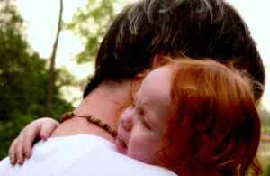 Sad-crying-redhead-toddler-hugging-dad