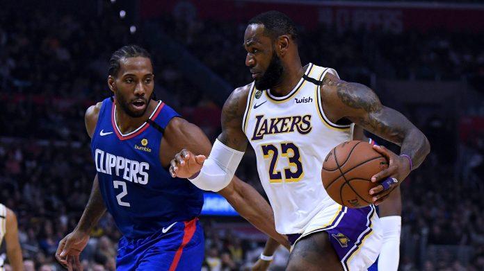 Kawhi Leonard of the Clippers, at left, guard Lakers forward LeBron James