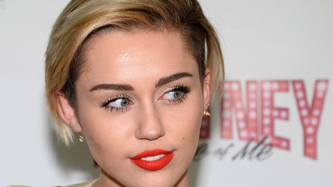 Miley Cyrus attends Britney Spears' show in Las Vegas.