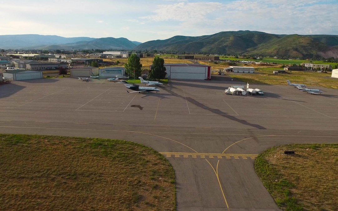 Heber Airport Ramp with jets in front of a hangar