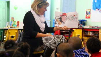Beverly Hale reads to children at a local daycare as part of the Indianola Promise Community's child literacy program.