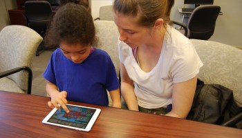 Jessica Green and her daughter, Ceriyanna Green-Ross, explore an educational app together during a Tech Goes Home early childhood course in Chattanooga, Tennessee.
