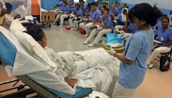 Students in the Jewish Homes's geriatric career development program take summer classes taught by registered nurses at Hostos Community College.