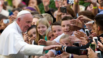 Pope Francis shakes hands with school children as he departs the Apostolic Nunciature, the Vatican's diplomatic mission in the heart of Washington, en route Andrews Air Force Base, Thursday, Sept. 24, 2015.