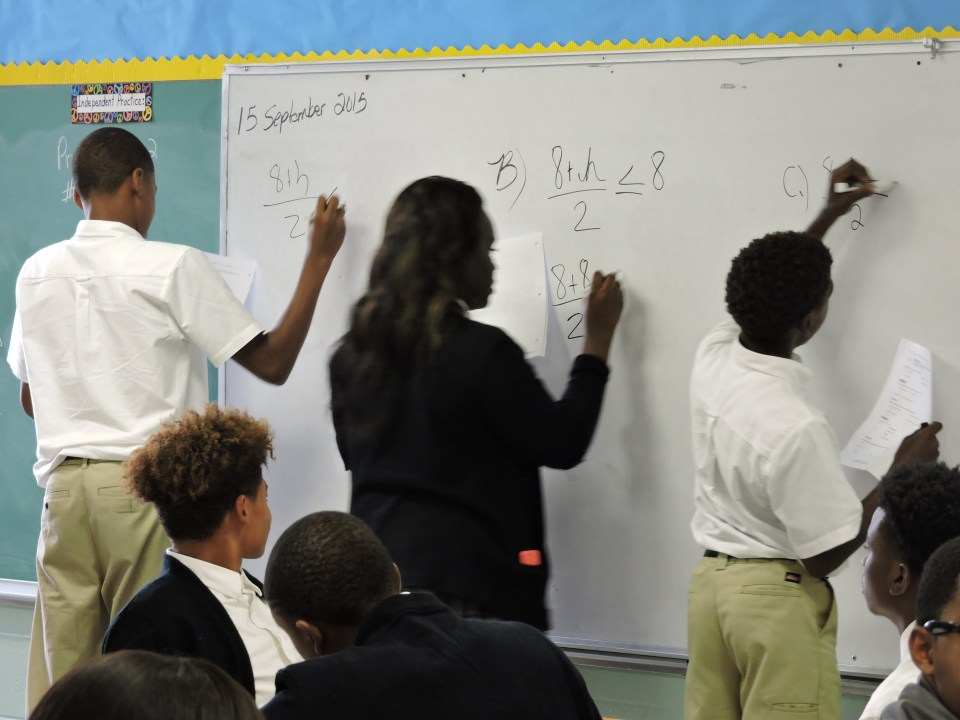 Students in Leslie Lewis' math class work at the board.