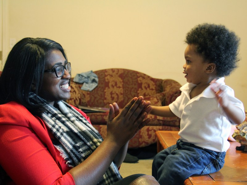 Mississippi parent Annita Bonner plays with her infant son before heading to work. The Too Small to Fail campaign is aimed at getting more parents to interact with their small children like Bonner is doing here.