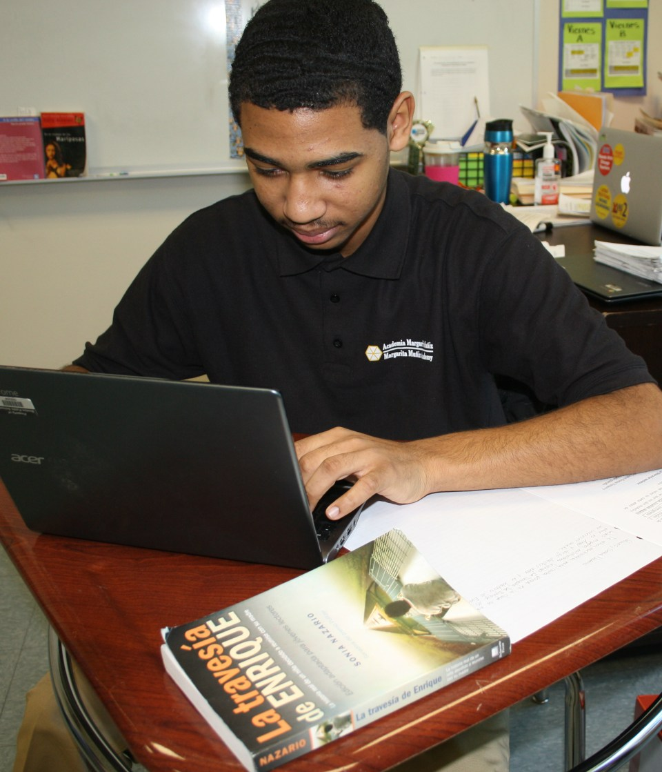 Ángel Díaz, 16, works on an assignment in his Spanish-language humanities class at Margarita Muñiz Academy in Boston.