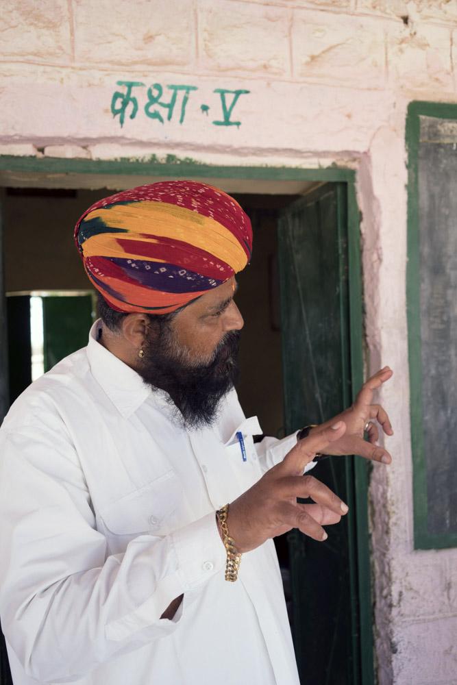 Vijay Ballani, also known as Mr. Desert, goes door-to-door in the Jaisalmer region to encourage parents to send their children to school.