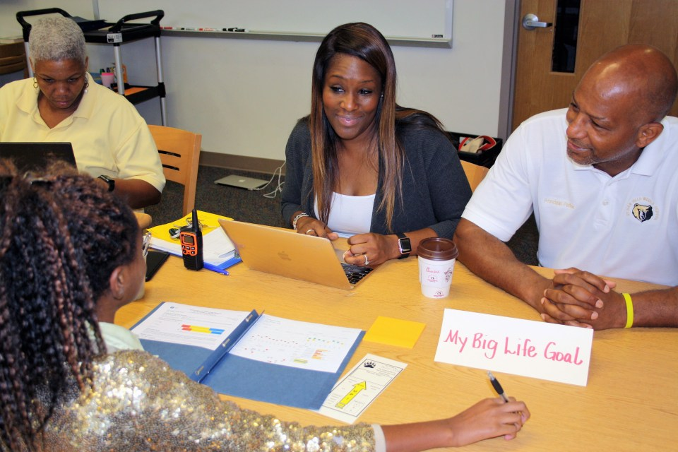 "Sylvan Hills Middle School Assistant Principal Monica Blasingame, center, and Principal Artesza Portee, right, discuss ""big life goals"" with a student as part of a goal-setting exercise in Atlanta Public Schools."