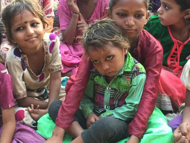Students at a village school gather for a performance.