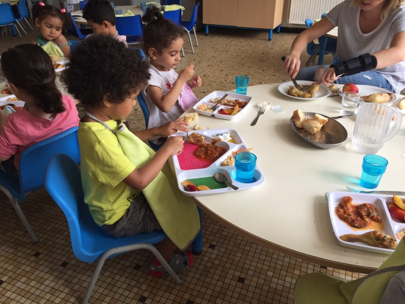 A group of 2- and 3-year-olds enjoy a lunch of fish, ratatouille, fresh bread and fruit at a preschool program in Lormont, a suburb of Bordeaux.