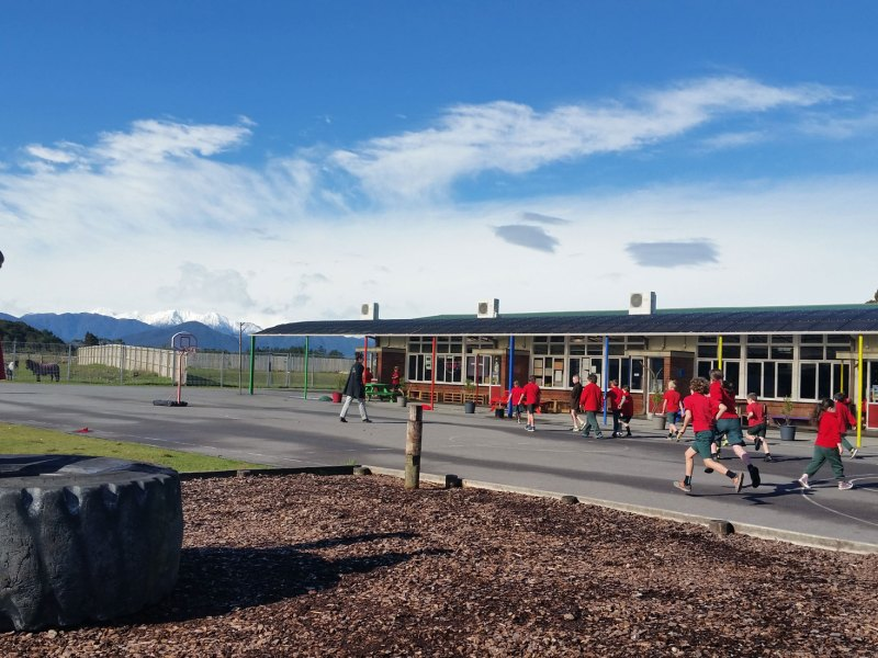 Children play outside during recess at Hokitika Primary School. Last year, the school lost 10 students to a nearby, more affluent school.