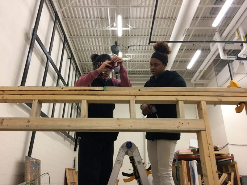 """High school junior Tania Toriz, 16, and sophomore Jade Boling, 15, fix a screw on the top of a shed that their """"Geometry in Construction"""" class constructed at Ritenour High School near St. Louis, Missouri."""