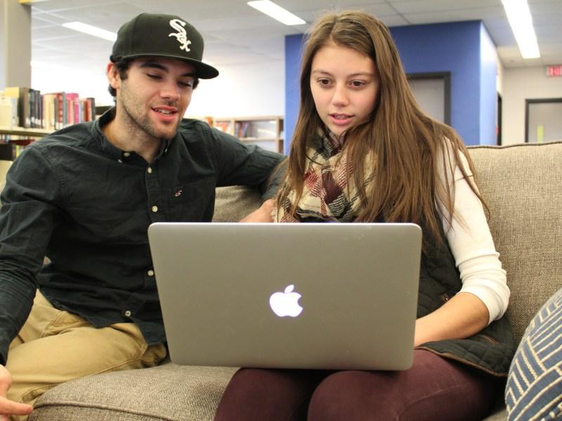 Junior Alex DesRuisseaux and senior Jesus Garcia work in the library of the University of Maine at Presque Isle.