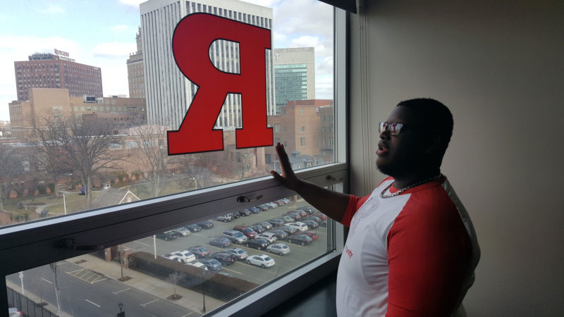 Rutgers Newark freshman Saied Beckford, an 18-year-old freshman, points out downtown Newark landmarks from his seventh-floor suite in a campus residence hall.