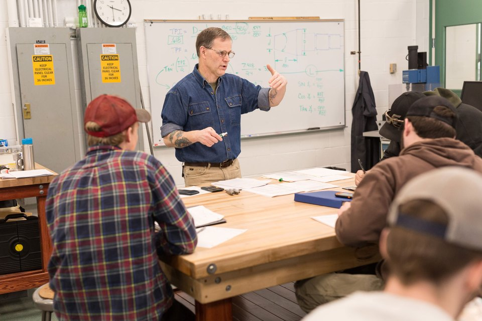 Professor Christopher Gray teaches students at Vermont Technical College in one of the school's manufacturing lab spaces.