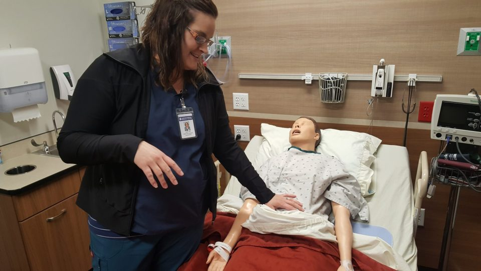 Bismarck State College nursing instructor Lacey Johnsrud shows off Sally, a training mannequin at the college's nook at Sakakawea Medical Center in Hazen, North Dakota.