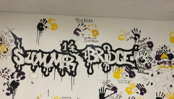 Participants from the college's Summer Bridge program traditionally leave their mark on campus in the school colors of black, purple and gold.