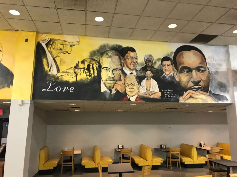 The dining hall walls at Paul Quinn College are painted with murals depicting famous African-Americans and other heroes.