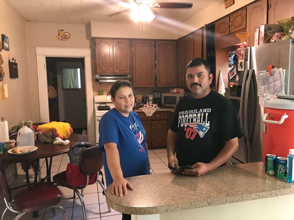 Oralia Rubio, left, and her husband, Hermenegildo, stand in the kitchen of their home in Honey Grove, Texas. Hermenegildo was one of 159 workers arrested at the Load Trail trailer plant in nearby Sumner on August 28, 2018. He now faces possible deportation.