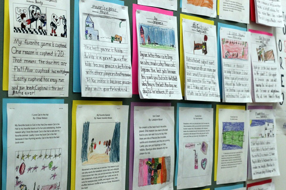 The classroom walls of Mott Haven Academy Charter School are covered in student work.