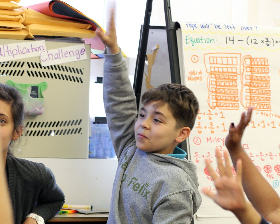 """Brandon in his fourth-grade classroom at Mott Haven Academy Charter School. Brandon enrolled in the school as a kindergartner after his mother learned about the program from a counselor in """"preventive services."""""""