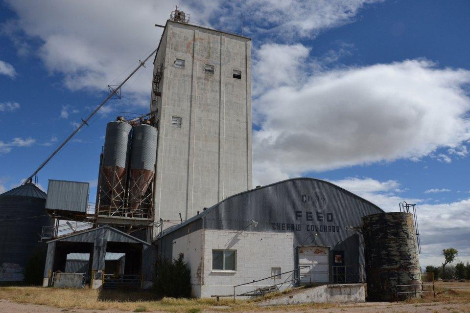 An old grain elevator rises in Cheraw, Colorado.