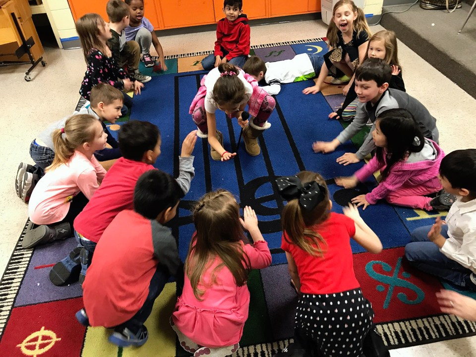 One of the benefits of a full day of school, Main Dunstable Elementary School principal Kelley Paradis said, is that kindergartners now get to participate in the New Hampshire school's specialized classes, like the music class pictured here.