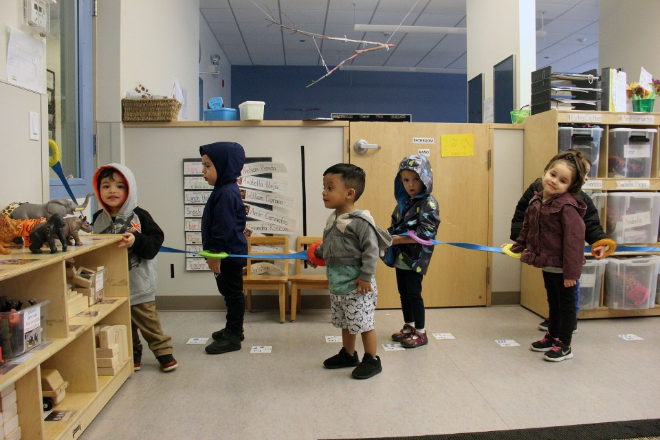 Students in the 2-year-old room at Christopher House's Belmont-Craigin location line up for a walk.