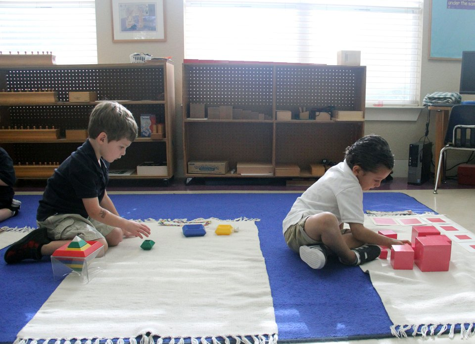 Students work independently in a classroom at Hill Country Montessori.