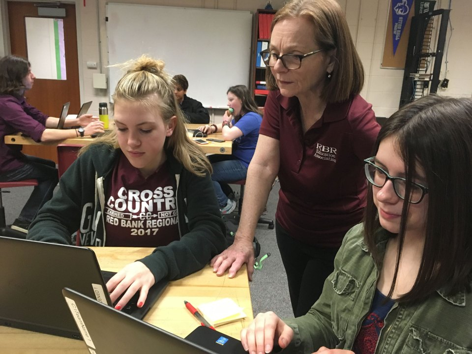 "In an effort to get more girls at Red Bank to participate in the cybersecurity challenge, teacher Mandy Galante, center, recruited girls from nontech classes, including a dozen from a creative writing class. ""We want to get the girls who never even thought of doing this,"" she said."