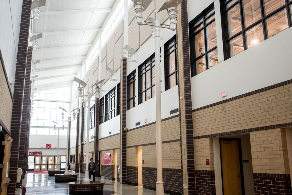 The atrium of Whitmore Lake High School, part of a nearly $48 million capital campaign approved by voters in 2006. The district has struggled since then to pay off its construction debt.