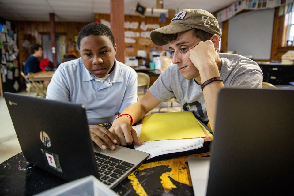 Arthur Evans III, left, gets homework instructions at the Rosedale Freedom Project from its founder and director of programming, Jeremiah Smith, in Rosedale in early November.