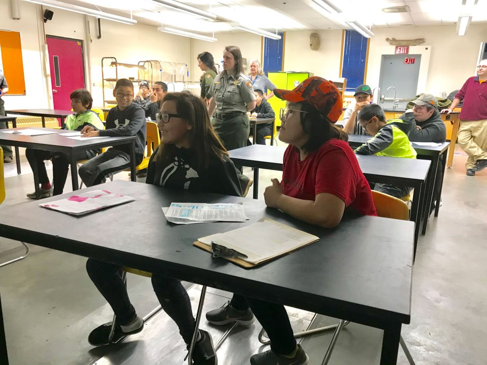 Eighth-graders Avril Seppilu, 13, right, and Tia Prentice, 13, left, listen during a Google Hangouts Meet video call to students in Hawaii. With greater bandwidth on its new fiber-optic internet connection, Nome teachers plan to do more live video streaming.