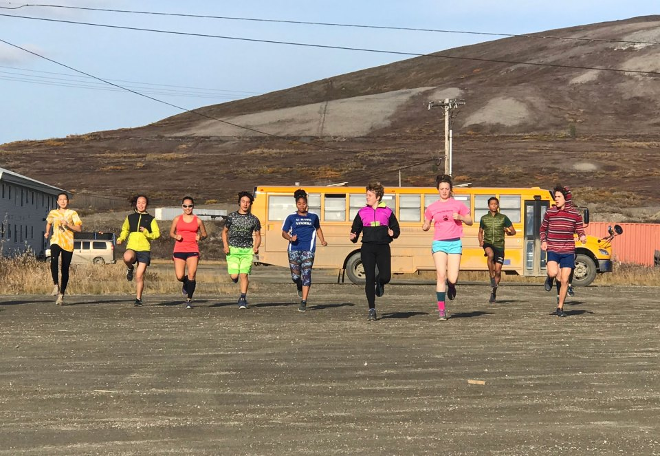 Cross-country student-athletes practice behind Nome-Beltz Junior/Senior High School during an unseasonably warm September afternoon.
