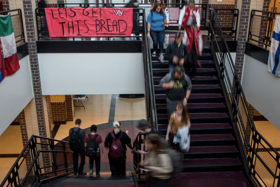 Students move between floors at Whitmore Lake High School, a spacious facility that is under capacity as enrollment has steadily declined in recent years.