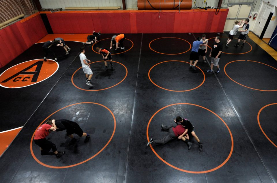 The high school wrestling team for Unified School District 377 practices in the elementary school's multipurpose room, the only space available in the rural Kansas district where the mats can be stored.