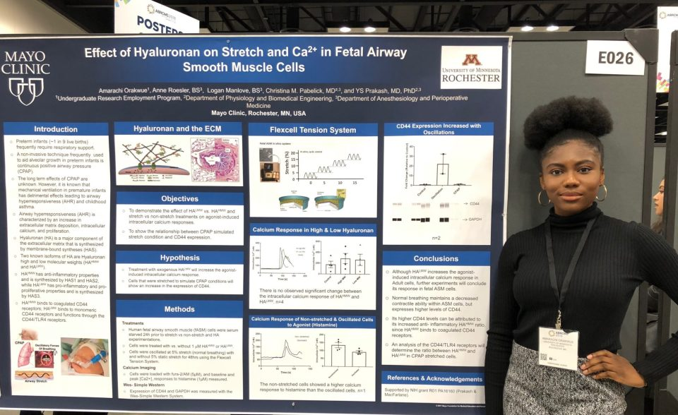 Amarachi Orakwue stands beside her poster summarizing research that she worked on at the Mayo Clinic, taken at the 2018 Biomedical Research Conference for Minority Students in Indianapolis.