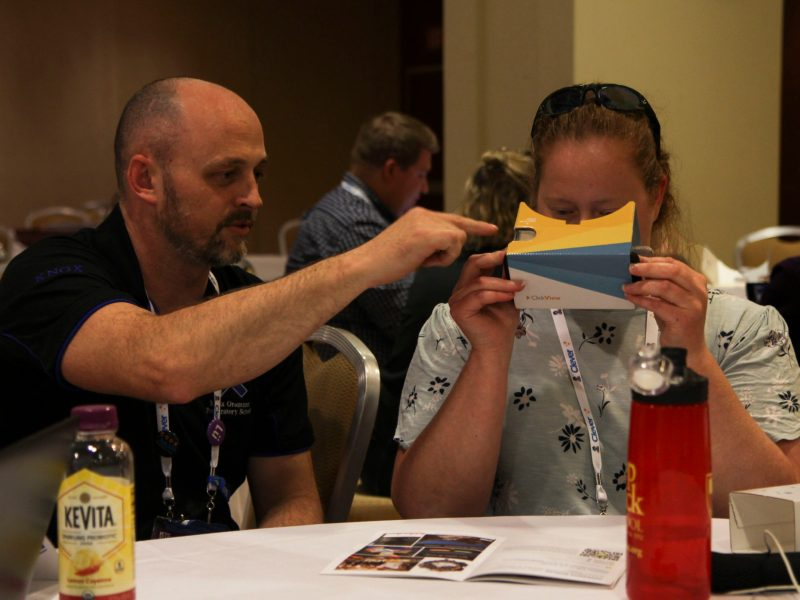 Ian Fairhurst, who integrates educational technology into grades K-6 at Knox Grammar Prep, showed a session participant how to use a VR headset at the ISTE conference in Philadelphia.