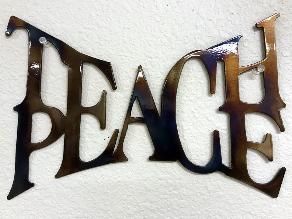 This sign hangs in the classroom of history teacher Ned Dougherty, the latest in a line of local teachers to lead Taos High students through a three-day retreat experience meant to help them take care of their emotional and mental health.