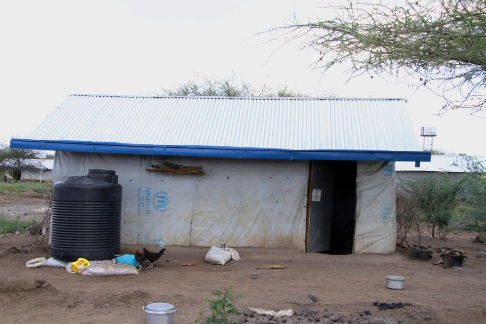 Homes in Kakuma are small, single-room dwellings constructed out of tarp, metal or mudbrick.