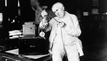 Inventor Thomas A. Edison examines film. (AP Photo)