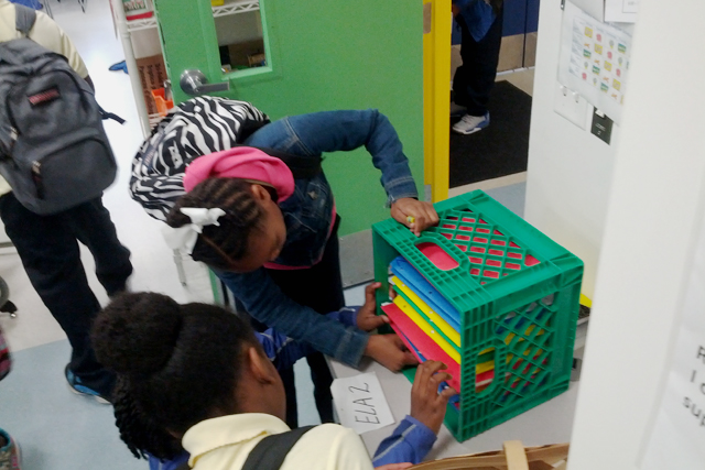 Students put away folders at the end of an English and language arts class at Anne Beers Elementary School. Valyncia O. Hawkins found a new use for milk crates – they are the perfect size for storing the folders. (Photo: Nichole Dobo)