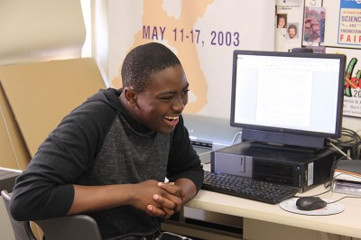 Edward Aryee, a senior at Ossining High School, talks to other students in the science research program. Aryee says the program inspired him to pursue science in college. (Photo: Jackie Mader)