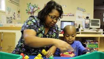 Jennifer Calvert, director of the ABC Pre-School & Nursery Inc. in Aberdeen, Miss., helps a student build a pattern during a morning activity earlier this year. Educators say early education is critical to fix Mississippi's education deficiencies. (Photo: Jackie Mader)