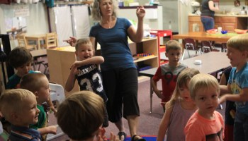Pam Jones of Learning in Motion preschool leads children in an exercise that incorporates movement with academics, Wednesday, Aug. 20, 2014, in Redding, Calif. (AP Photo/Record Searchlight, Andreas Fuhrmann)
