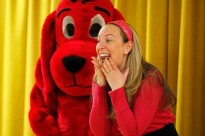 A Scholastic sales representative dressed up as Clifford the Big Red Dog, and Newark math specialist Darlene DeVries played Clifford's owner, Emily Elizabeth, at a book giveaway at Quitman in November. (Amanda Brown / NJ Spotlight)